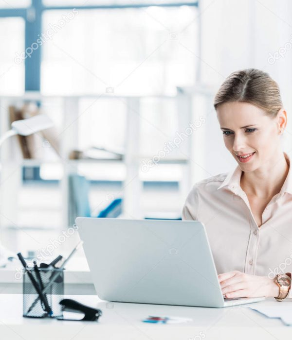 depositphotos_153610432-stock-photo-businesswoman-working-on-laptop-at